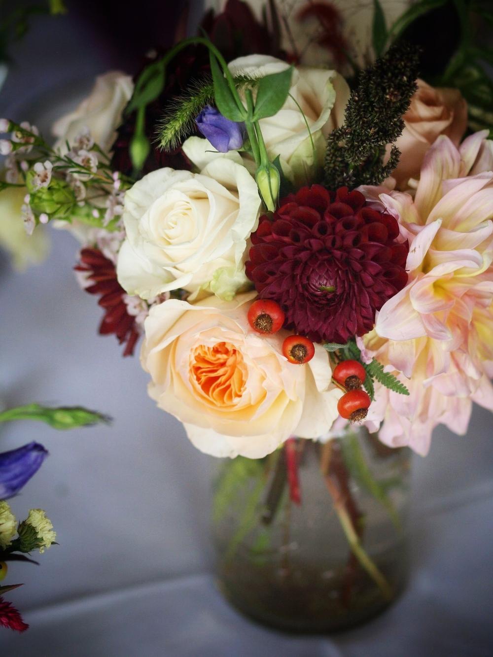 Oreonta house woodstock wedding mason jar centerpiece with garden rose dahlia and wildflowers.jpg