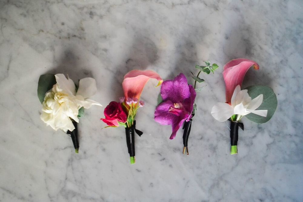 Orchid and calla lily boutineers.  Rosehip Social, Brooklyn, NY.