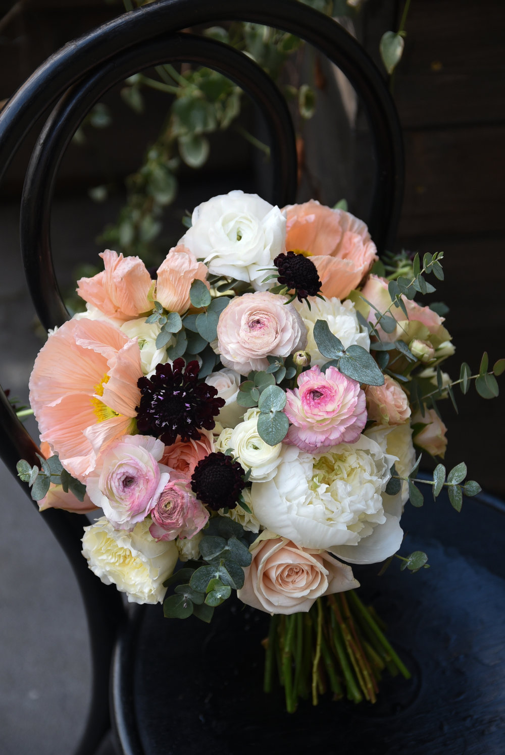 Bouquet of peach, pink, blue, and black