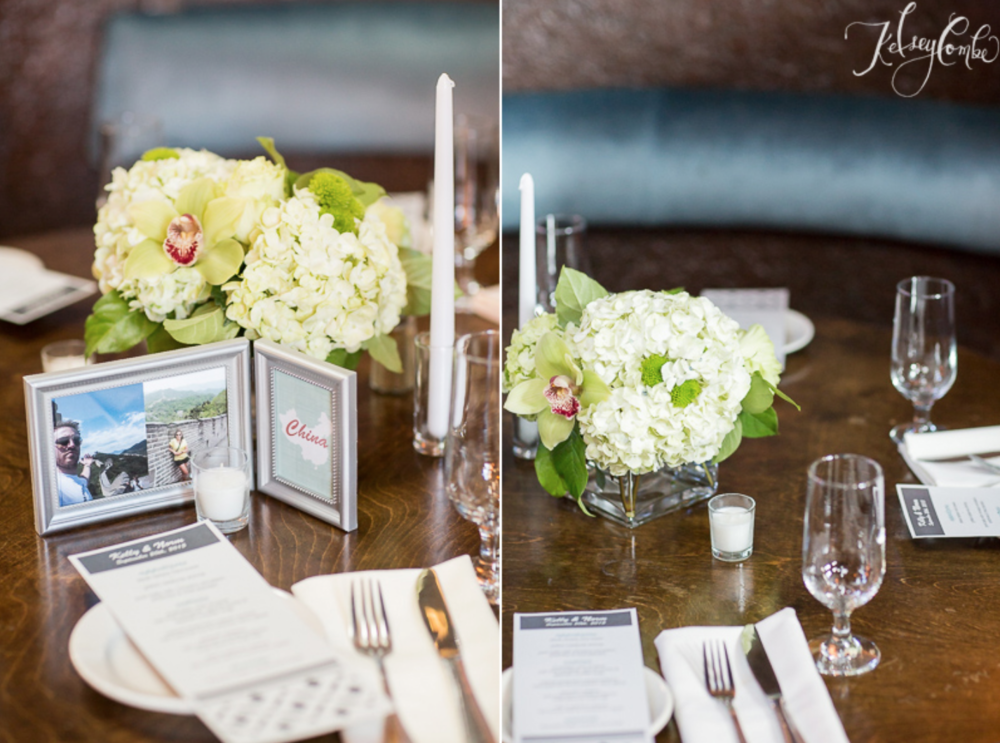 Hydrangeas, orchids, and mums in a travelers centerpiece