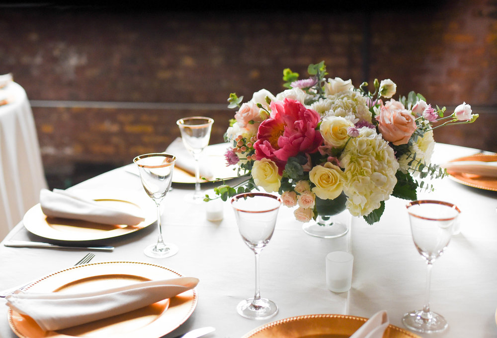 This pink and white centerpiece adds a bit of height to the table at this Brooklyn summer wedding