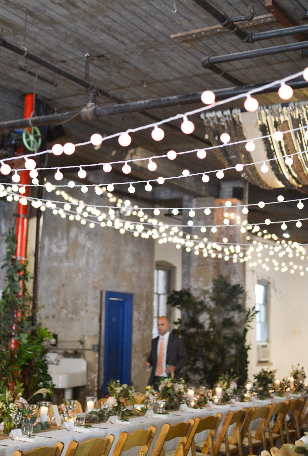 Lovely string lights over the wild garden style tables at this Brooklyn wedding