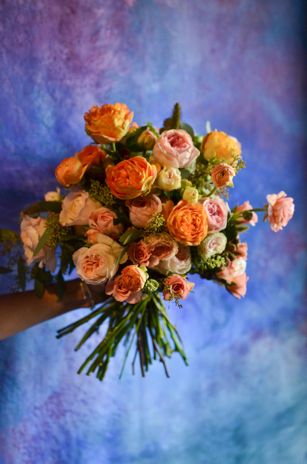 A bridal bouquet that resembles a rose garden