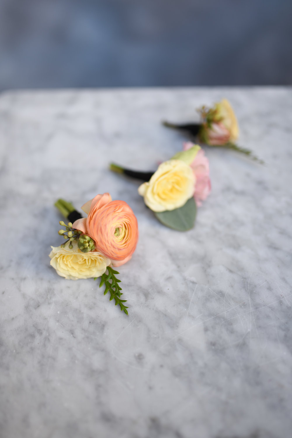 Another view of the boutonnieres for this colorful fall wedding in Brooklyn, New York