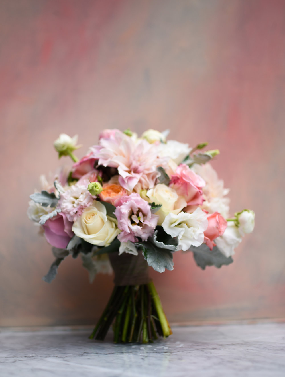 This bridal bouquet for an early fall wedding has soft, feminine, and beautiful pink tones