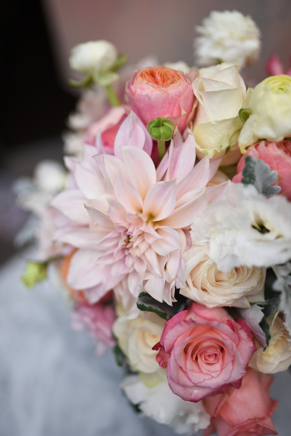 A closeup of the dahlias and garden roses in the bridal bouquet for this fall wedding at MyMoon