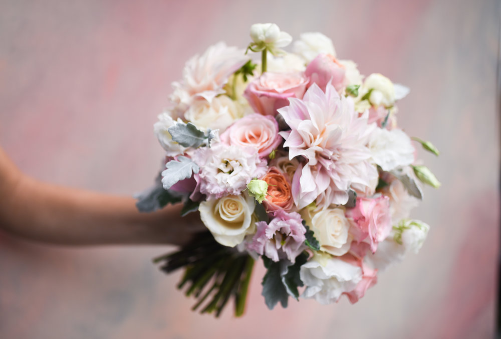 Its impossible not to be impressed with the lovely dahlias in this bridal bouquet, a perfect choice for a late September wedding!