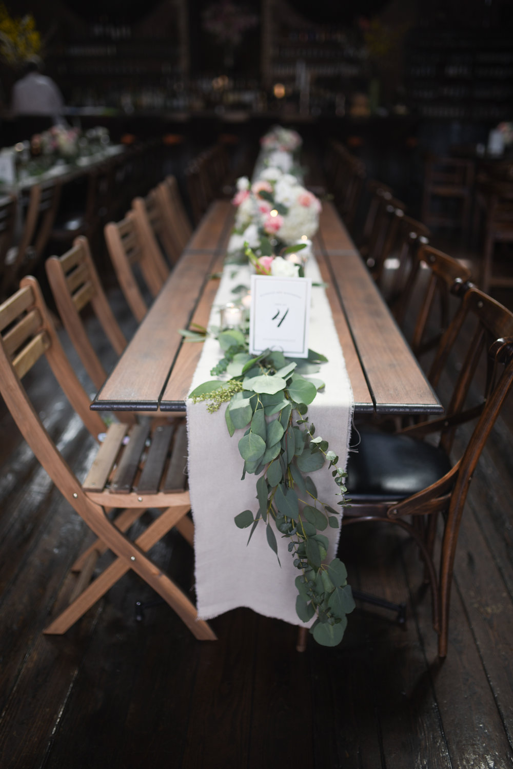 A cascading garland for the tables at this wedding at MyMoon venue in Brooklyn, New York