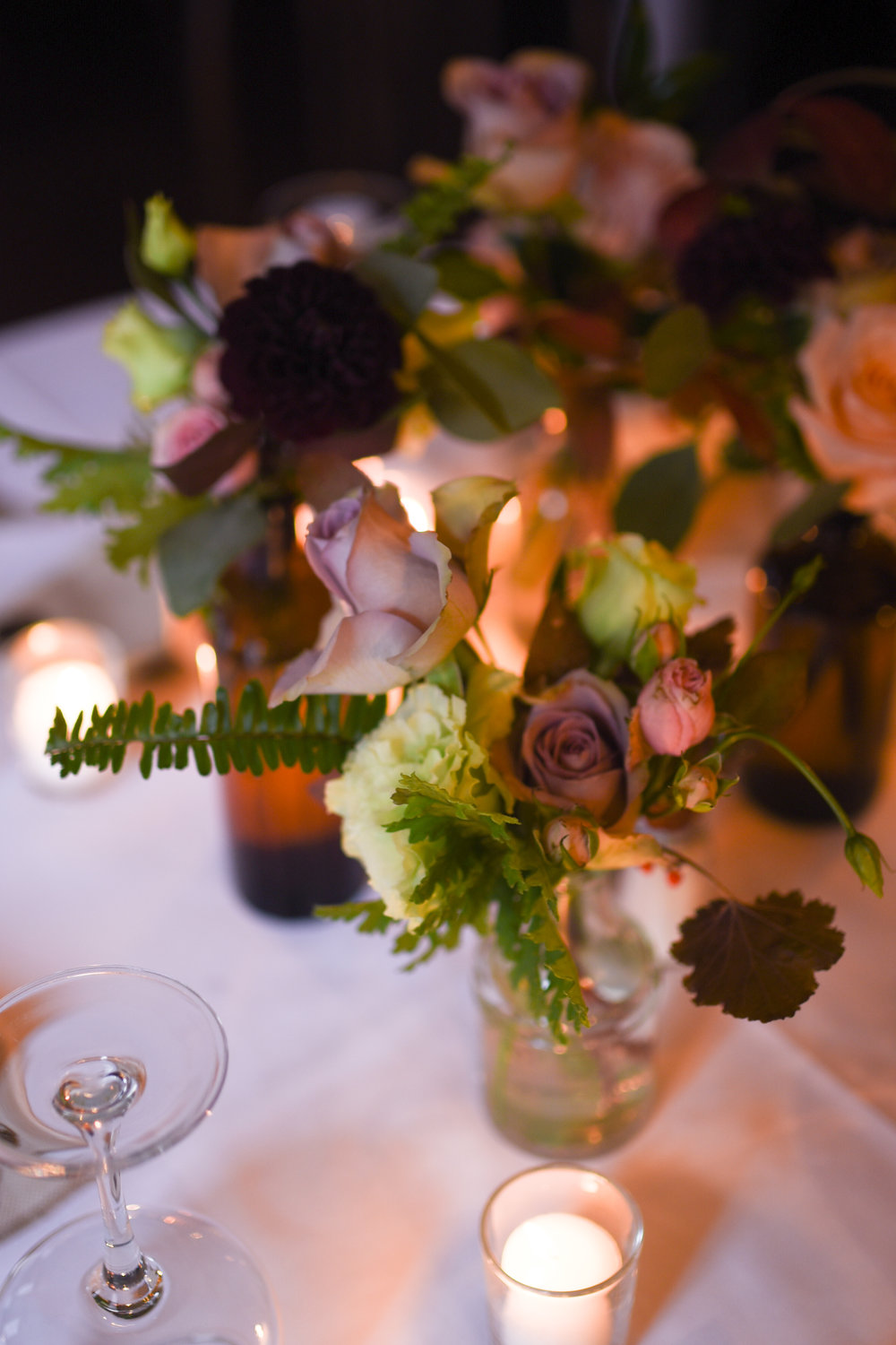 Bud vases on the tables at Orsay restaurant for this October wedding