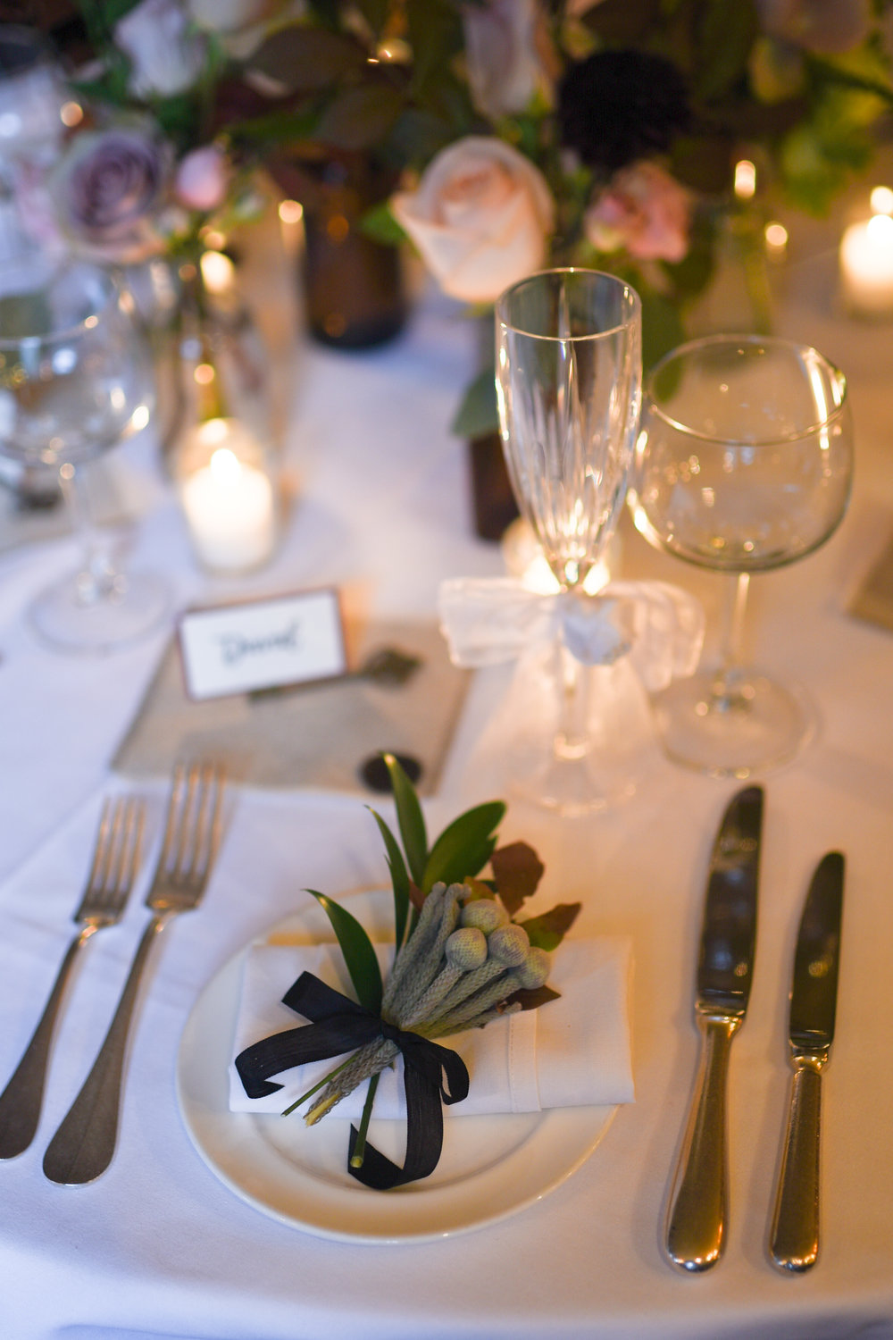 A tiny bouquet with greens for the place settings