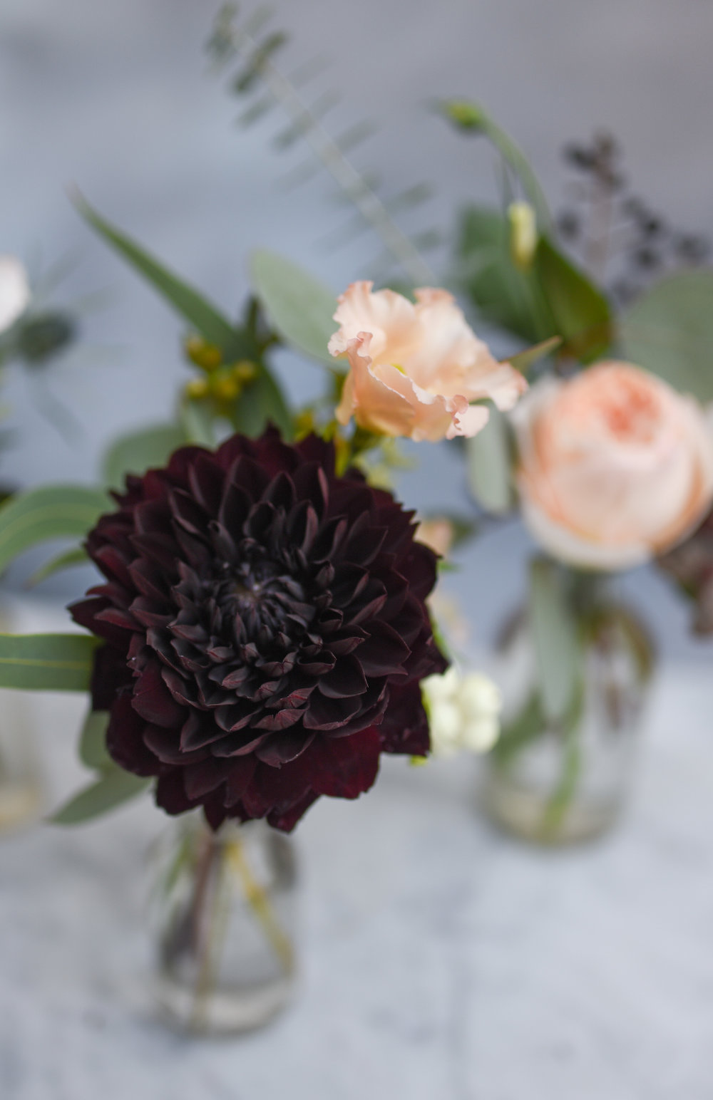 A closeup of the gorgeous dahlias for the bud vases