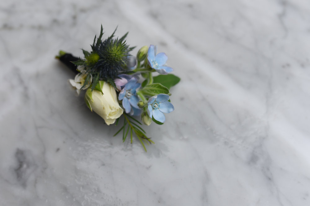 A blue and white boutonniere for this Brooklyn wedding