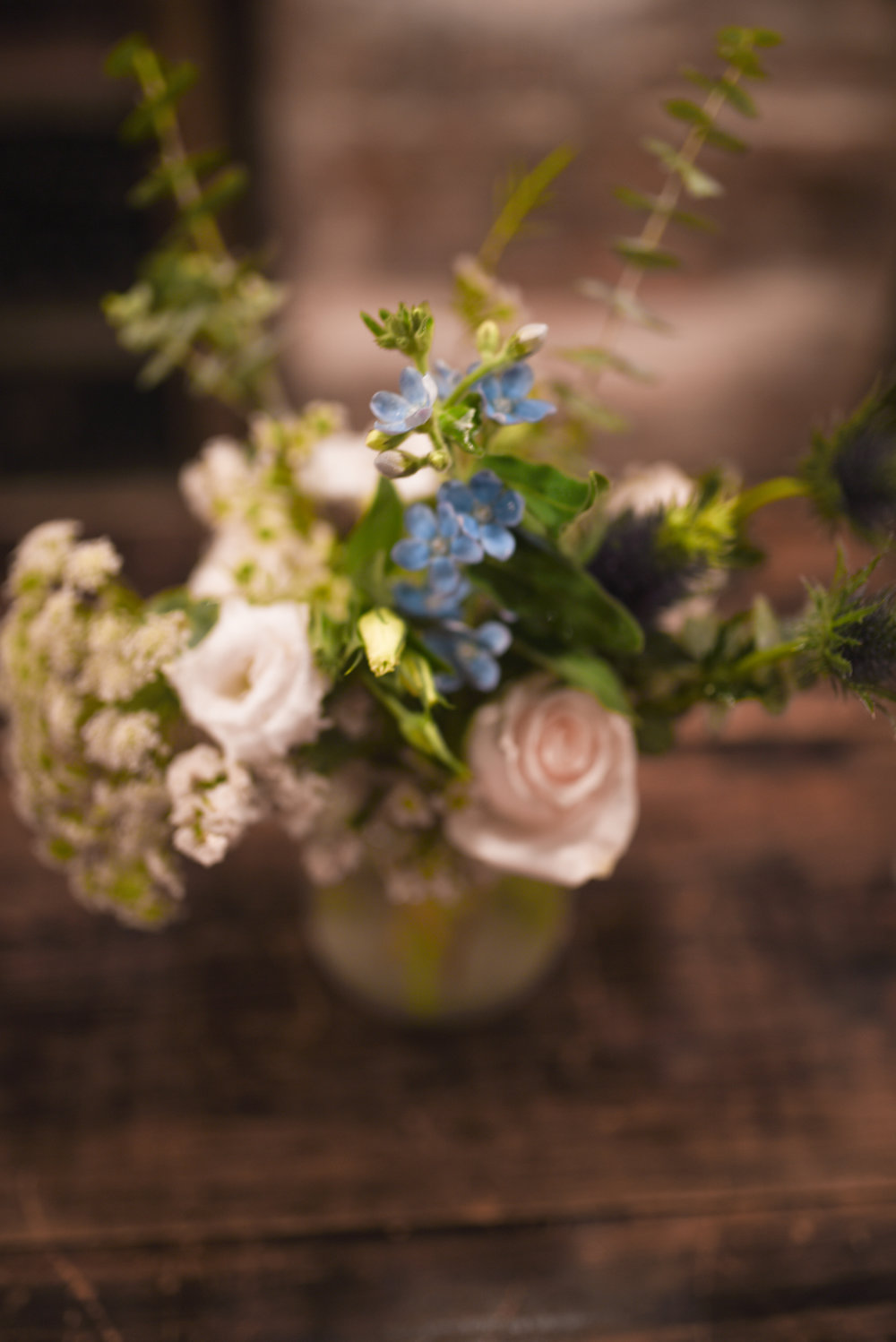 Mason jars with wild looking arrangements are lovely for this Brooklyn wedding reception