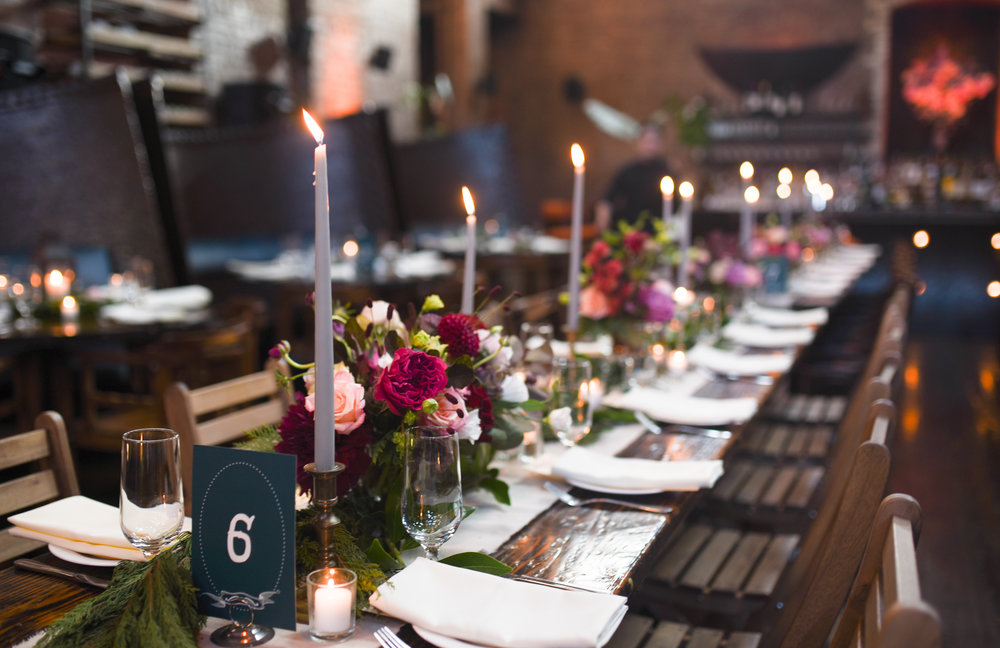 Tall candles pair with short, wide centerpieces