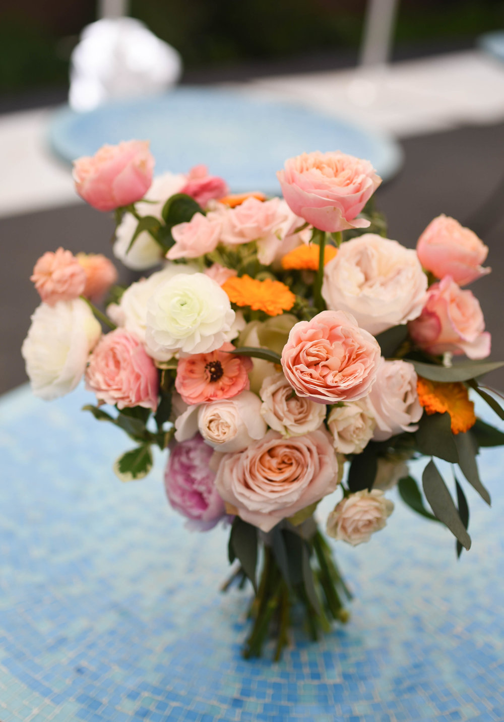 Soft citrus tones adorn the bridal bouquet for this Brooklyn wedding