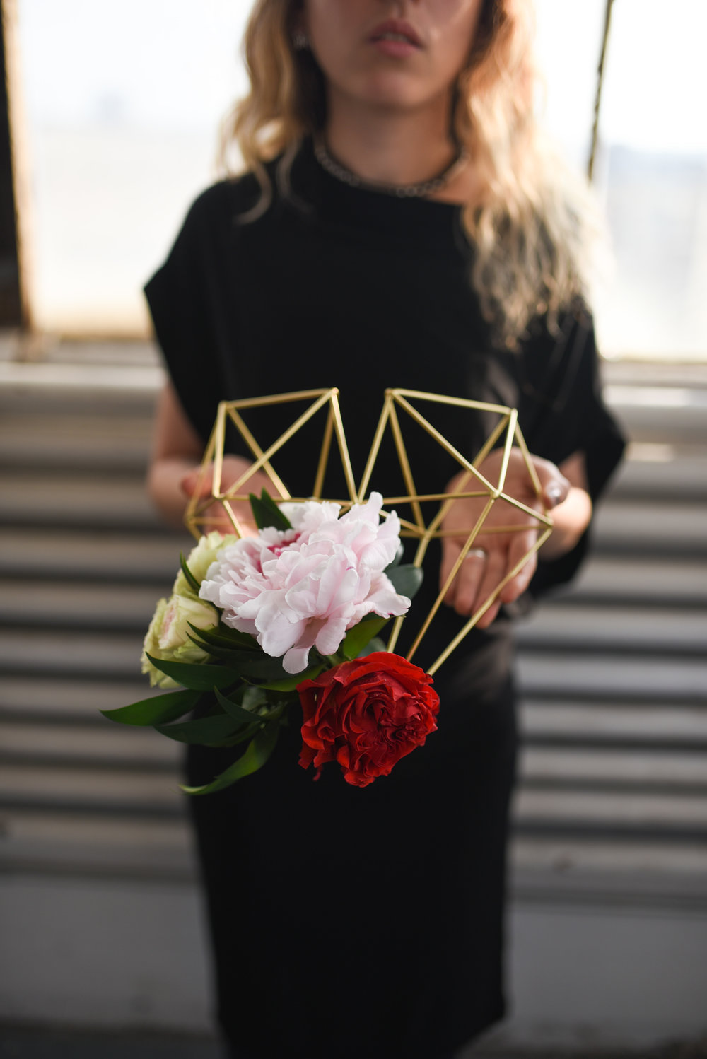 Spray roseds, peonies and garden roses on a geometric lantern