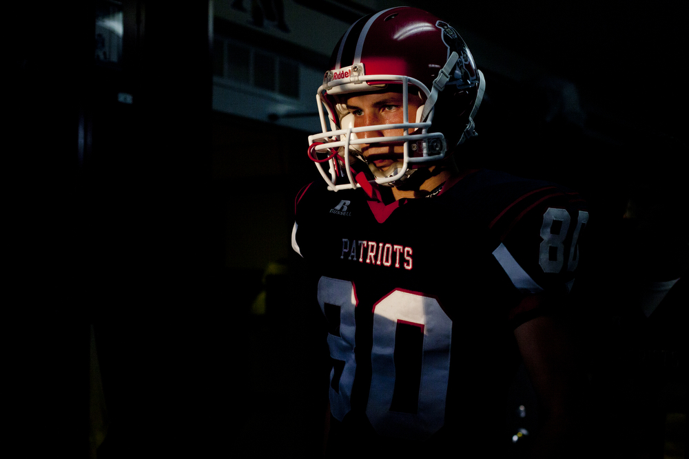 Heritage Hills' Logan Steckler walks out of the locker room before the game against Evansville Mater Dei at Heritage Hills in Lincoln City, Ind. on August 23, 2013. It was both the first game of the season and Steckler's birthday.  Mater Dei won 37-14.