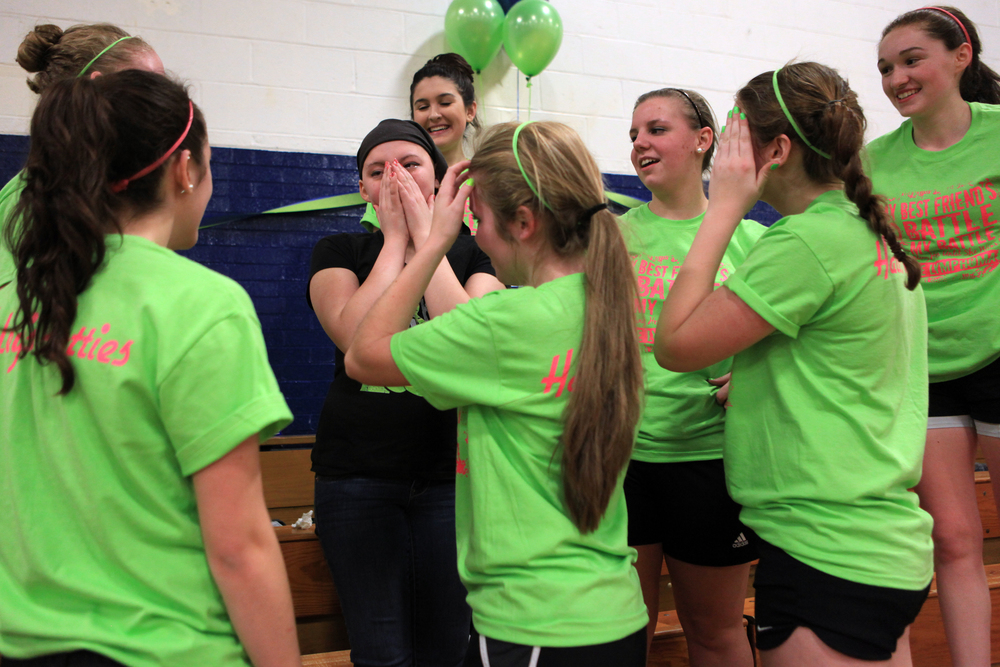 "Merrimack Valley sophomore Haley Roy, 15, who has Lymphoma, wiped away tears as her friends Molly Brochu, left, 15, Sierra Dube, 15, Celine Burrows, 15, Callie Brochu, 15, Kristen Simoneau, 15, Mariah Elkins, 15, and Izzy Hoyt, 16, surround her after performing a zumba dance to the song Roar that they learned specially for her during a Zumbathon fundraiser to help pay for her treatment on Sunday, January 19, 2014.  ""I don't know a lot of people here but they're all here for me.  It kind of blows my mind,"" said Haley."