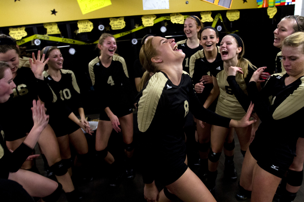 Jasper's Tori Sermersheim dances with her teammates in the locker room before the Class 3A girls volleyball sectional against Washington in Jasper, Ind. on Oct. 24, 2013.  The Wildcats won in three sets.