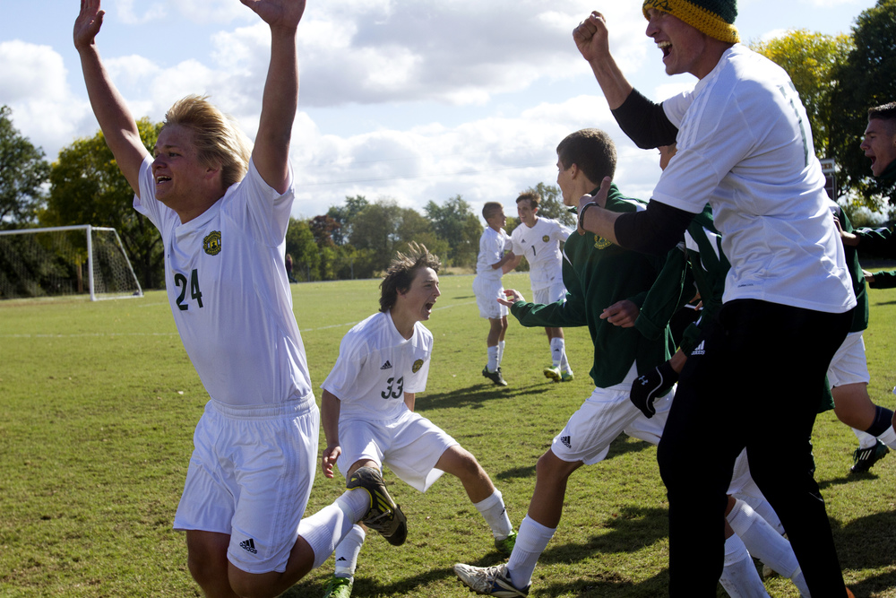 Forest Park's Joel Weyer, left, Spenser Sermersheim and Max Rickelman explode from the bench as the clock expires and the Rangers win the Class 1A soccer regional championship against Washington Catholic in Fort Branch, Ind. on October 19, 2013. The Rangers won 2-1.