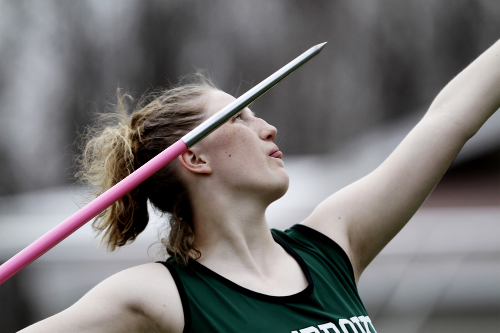 Pembroke Academy's Emily Carignan throws the javelin at the track meet in Pembroke, N.H. on April 22, 2014.