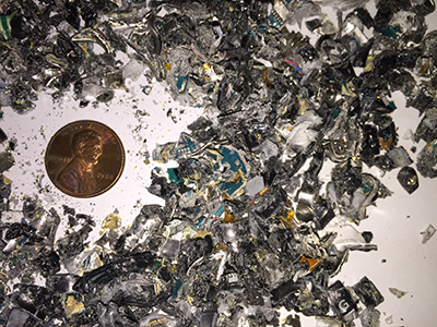"""3/16"""" (4x15mm) post-shred waste particle size."""
