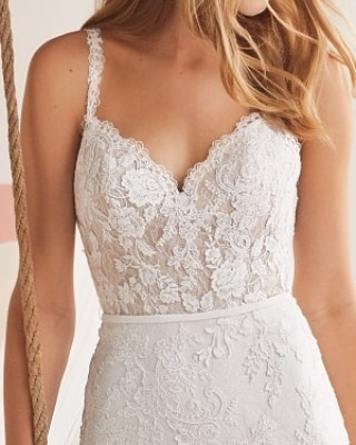 Timeless lace with a modern spaghetti strap AND a beautiful full lace back. This dress has it all! We'd love to see it on you!  #eleganzagallery #thewhiteone #whiteone #lace #weddings #weddingdress #chicagowedding #chicagobridalshop #engaged #bridetobe #weddingplanning #futuremrs