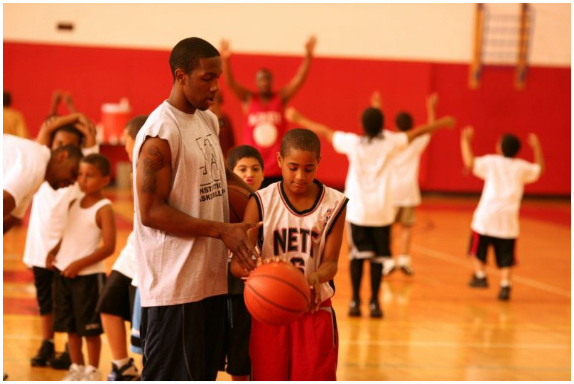 jerry assisting foul shooter camper.jpg