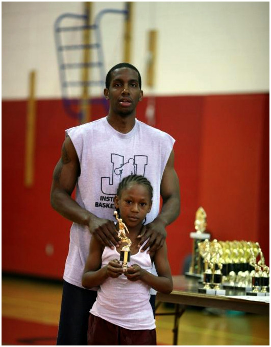 jerry with kid and trophy.jpg
