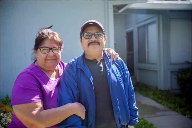Olivia and Jose Aguilar in front of their niece's home in Modesto. Photo by E. Tammy Kim and Lam Thuy Vo