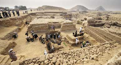 Egyptian archaeologists work at an ancient burial ground in Saqqara, dating back to 2,700 B.C.