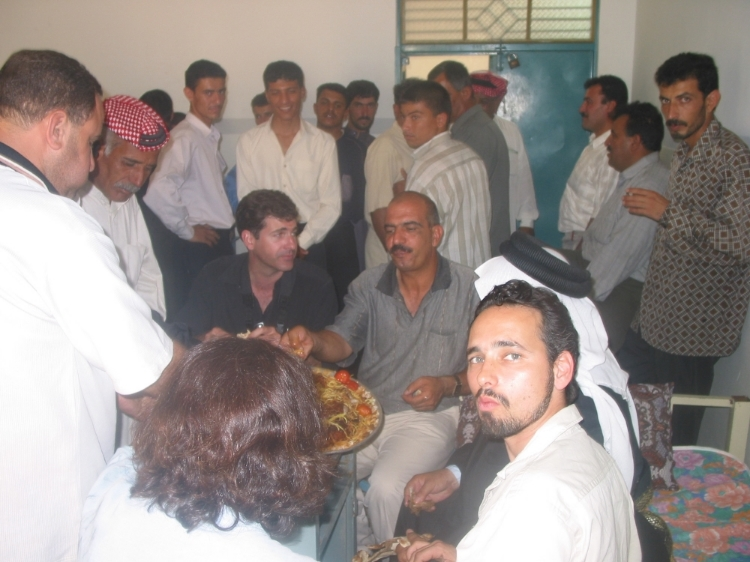 June 2003: Samir Al Jaburi, seated to the author's left, having lunch in Mosul after conducting an interview with a powerful Iraqi sheik of the Al Jabur tribe. In the foreground is Quil Lawrence of National Public Radio.