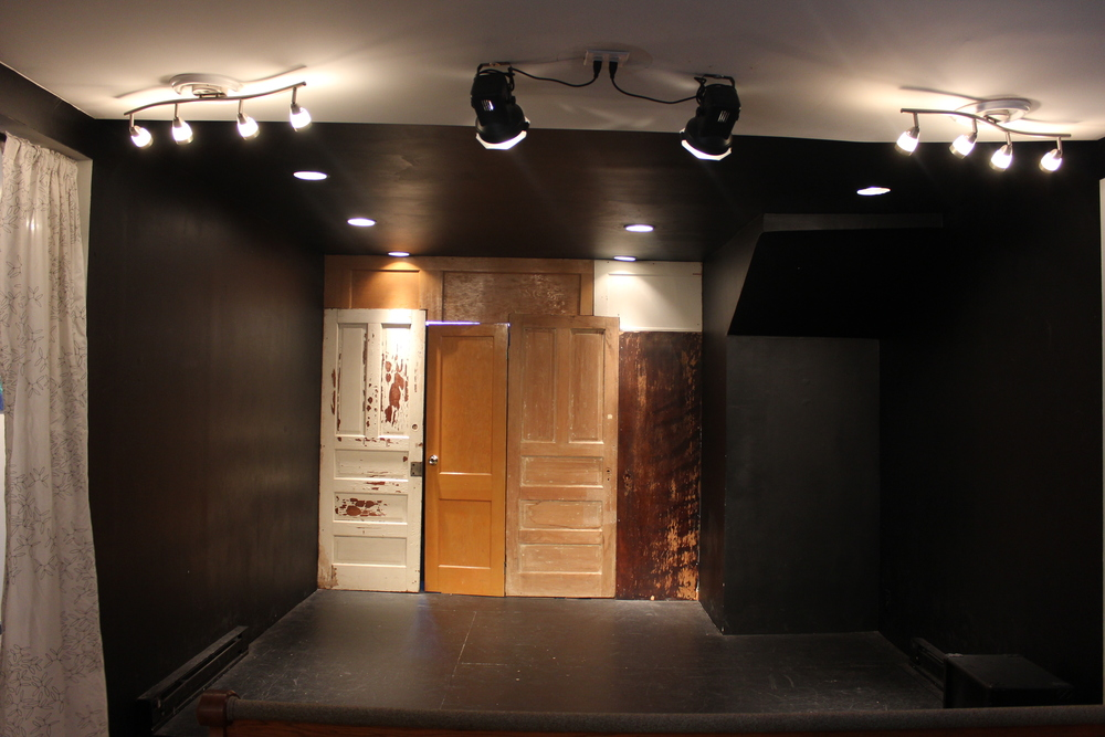 "View of stage and door to backstage ""green room"" area."