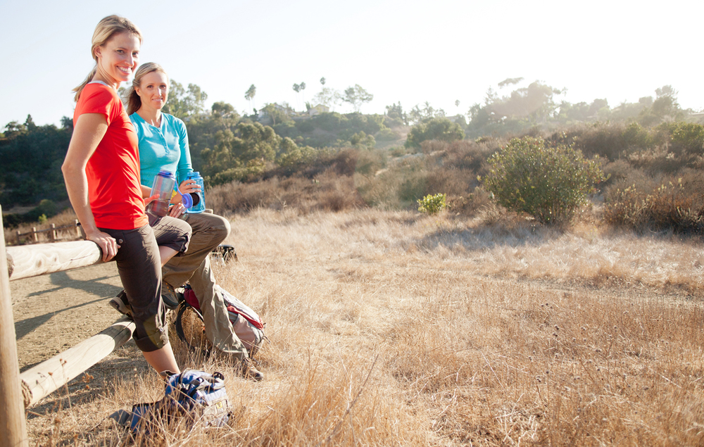 Girls taking a break while hiking. san diego lifestyle photographer, san diego lifestyle photography, southern California lifestyle photographer, California lifestyle photographer, lifestyle photo