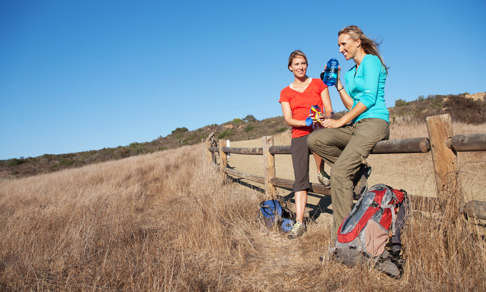 Girls hiking and stopping for a water break. san diego commercial photography, san diego commercial photographer, southern California commercial photographer, California commercial photographer