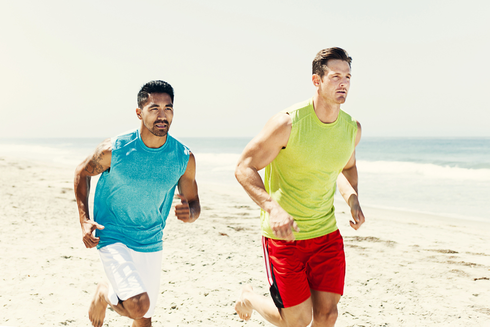Guys running on a San Diego beach. san diego commercial photographer, san diego fitness photographer, san diego fitness photography, southern sports photographer, California sports photographer