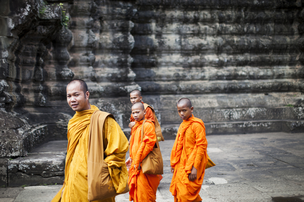 monks walking at angkor wat temple. san diego commercial photography, san diego commercial photographer, southern California commercial photographer, California commercial photographer