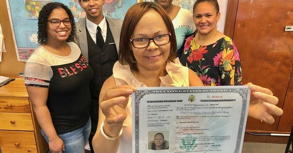 Martina proudly displays her Certificate of Naturalization.