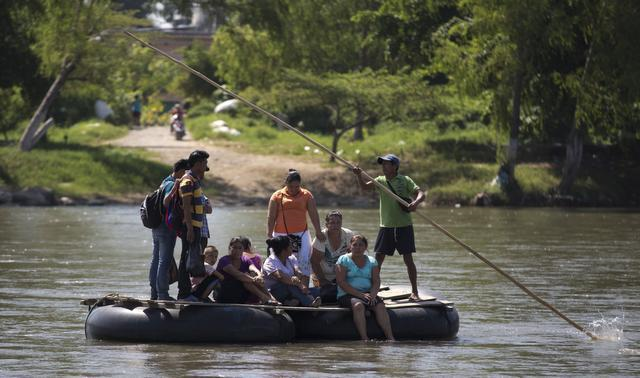 People are rafted across the Suchiate River to the shore at Ciudad Hidalgo, Mexico, from Tecun Uman, Guatemala, earlier this month.