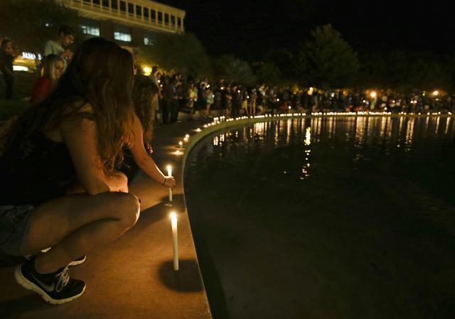 Students and supporters hold a candlelight vigil Wednesday at the University of Central Florida in Orlando, to honor Steven Sotloff, the second American journalist to be beheaded by the Islamic State group in two weeks. Sotloff attended the University of Central Florida between 2002 and 2004.
