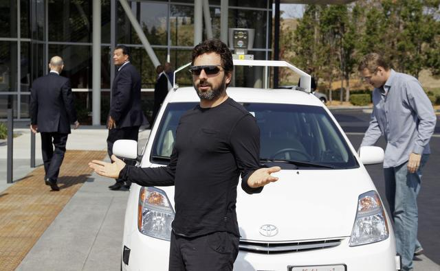 Eric Risberg/The Associated Press Google co-founder Sergey Brin, who emigrated from Russia, gestures after riding in a driverless car with Gov. Jerry Brown, left, in September 2012 in Mountain View. One way to punish Russia is to attract more like Brin