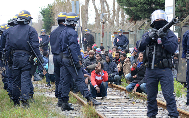 Migrants outside the Eurotunnel area, in Calais, northern France, last week. More than 3,000 migrants have tried to storm the area surrounding the Eurotunnel in an attempt to enter Britain.