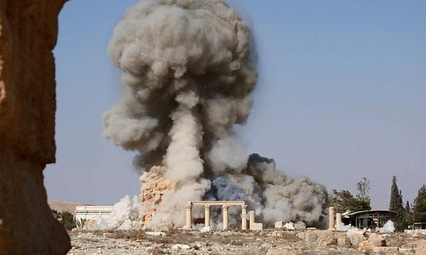 This photo released Tuesday on a social media site used by Islamic State militants, which has been verified and is consistent with other Associated Press reporting, shows smoke from the detonation of the 2,000-year-old temple in Syria's ancient city of Palmyra. Uncredited The Associated Press.