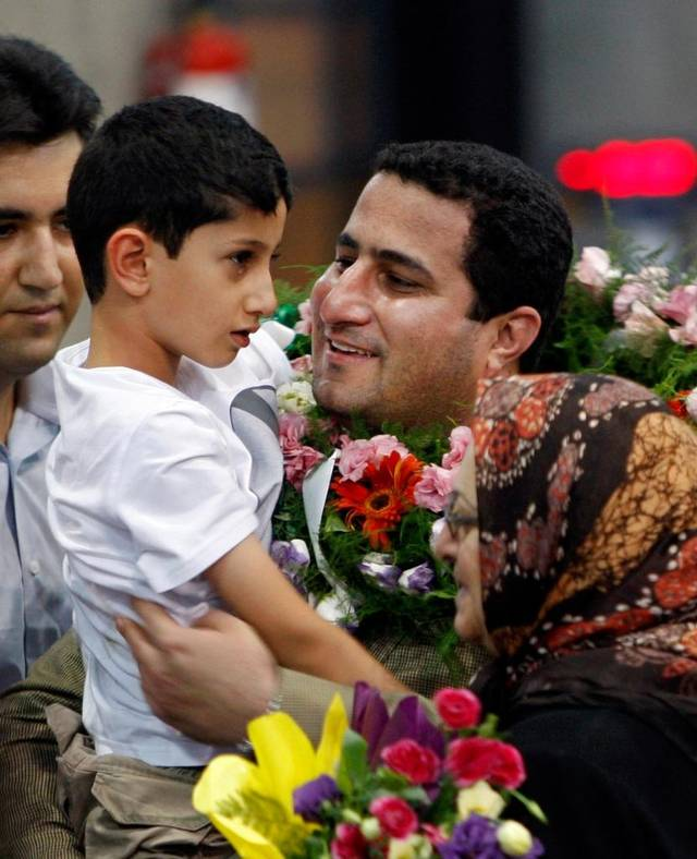 In this 2010 photo, Shahram Amiri, an Iranian nuclear scientist greets his son Amir Hossein as he arrives at the airport in Tehran, after returning from the United States. Amiri, who was caught up in a real-life U.S. spy mystery and later returned to his homeland, was executed under mysterious circumstances. Amiri was hanged recently. Vahid Salemi Associated Press file.
