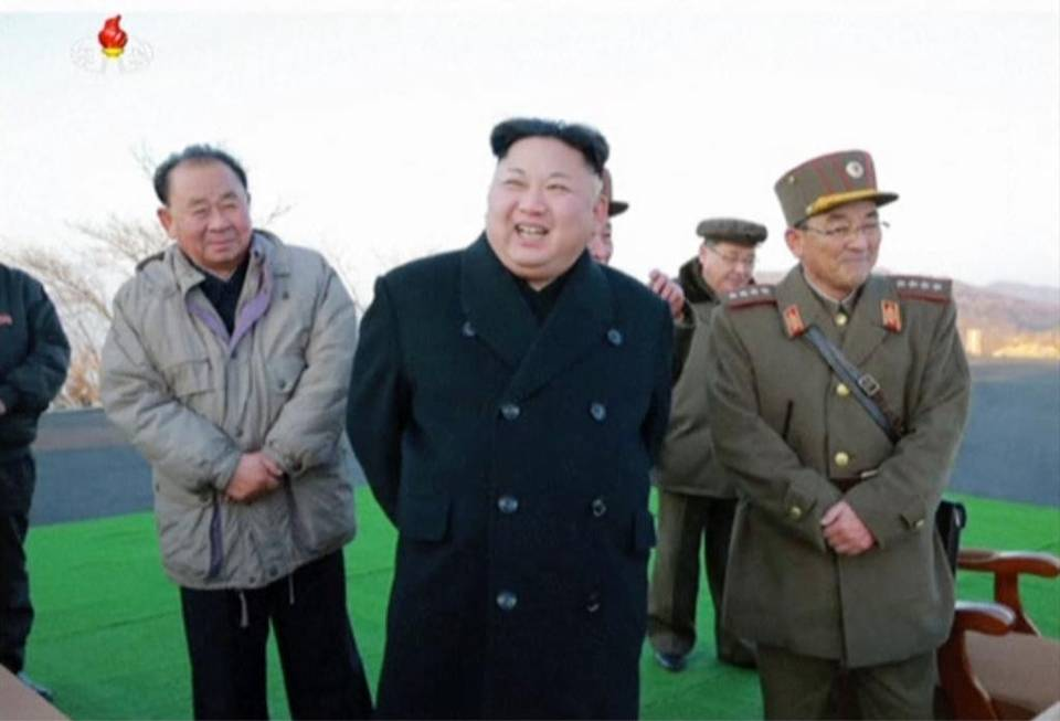 In this images made from video released by KRT on March 7, North Korean leader Kim Jong Un, center, reacts during the launch of four missiles in an undisclosed location North Korea. Kim Jong-un has likely taken the storyline of a movie about him and twisted it to kill his half brother.