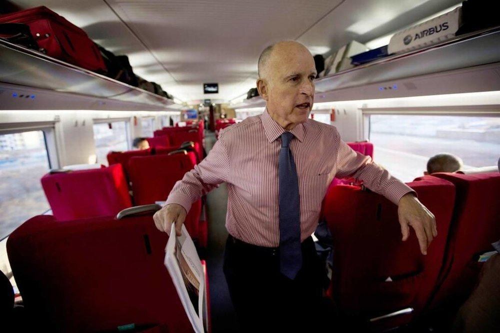 California Gov. Jerry Brown speaks to journalists on board a high speed rail leaving from the Beijing South train station during his last trip to China in 2013. Ng Han Guan ASSOCIATED PRESS