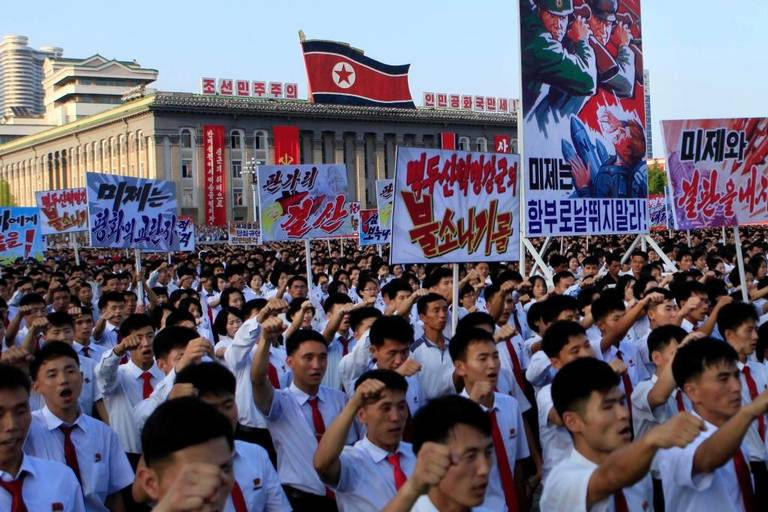 Tens of thousands of North Koreans gathered for a rally at Kim Il Sung Square carrying placards and propaganda slogans as a show of support for their rejection of the United Nations' latest round of sanctions on Wednesday Aug. 9, 2017, in Pyongyang, North Korea. Jon Chol Jin AP