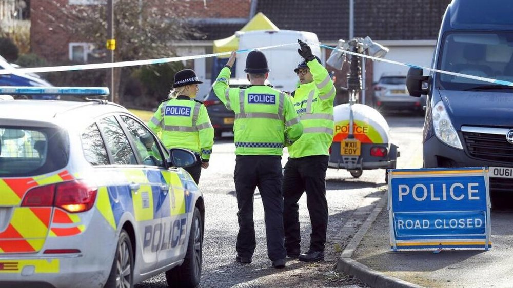 Police officers seal off a cul-de-sac in Salisbury, England, near to the home of former Russian ex-spy Sergei Skripal as a nerve agent is believed to have been used to critically injure him and his daughter Yulia. Britain's Home Secretary says the investigation into the nerve agent attack on a Russian ex-spy and his daughter is focusing on three sites â his home, a pub and a restaurant. Andrew Matthews AP