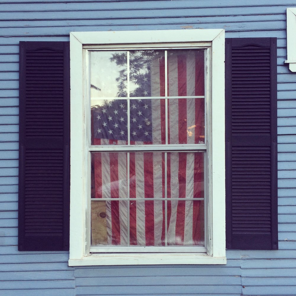 American flag hung in a neighbor's window.