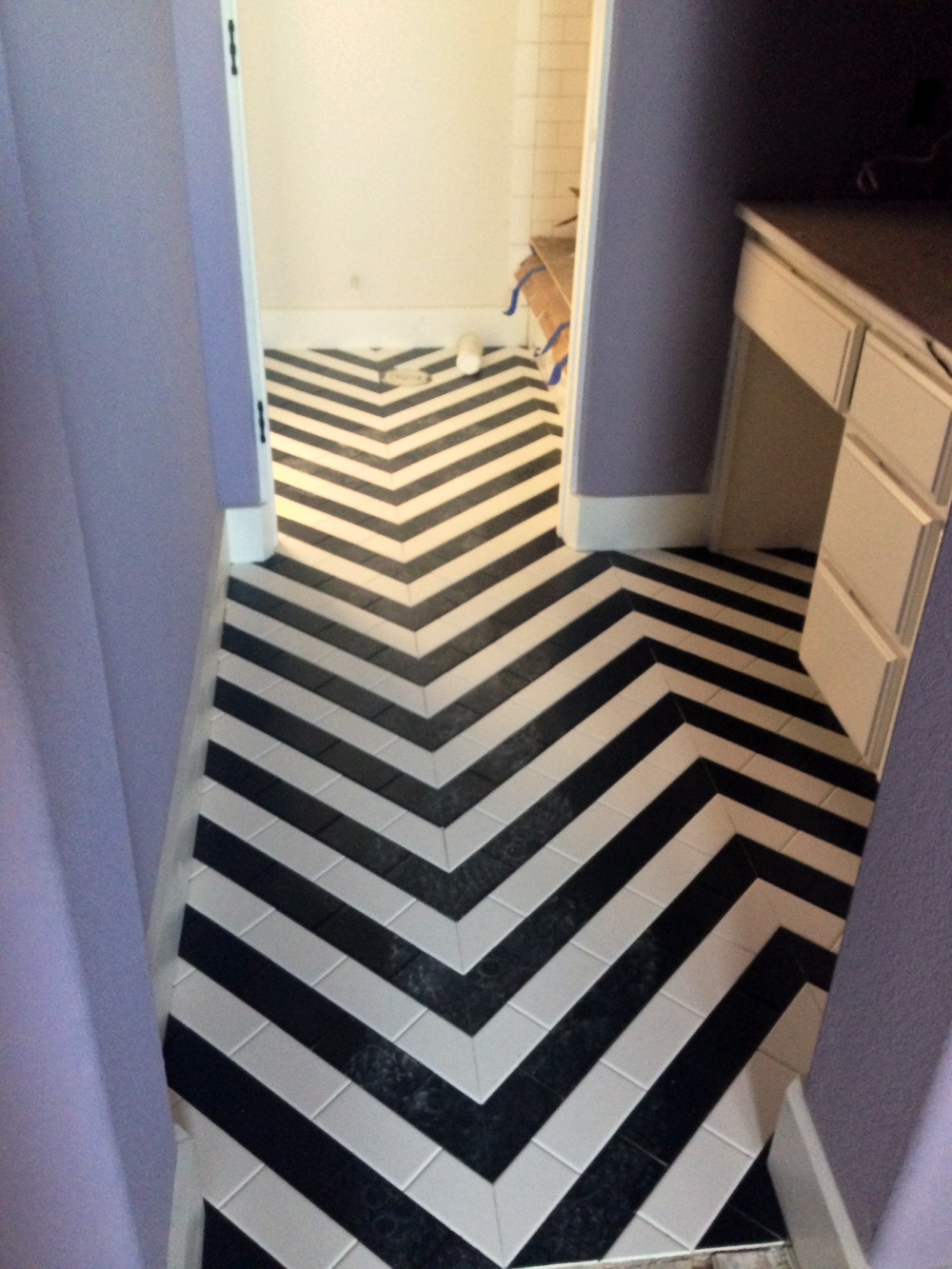black and white herringbone tile.JPG